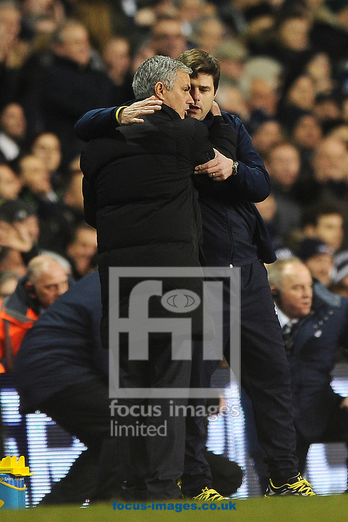 Chelsea Manager Jose Mourinho congratulates Tottenham Hotspur Manager Mauricio Pochettino just before the final whistle during the Barclays Premier League match between Tottenham Hotspur and Chelsea  at White Hart Lane, London<br /> Picture by Richard Blaxall/Focus Images Ltd +44 7853 364624<br /> 01/01/2015
