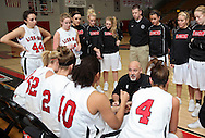 Linn-Mar head coach Michael Brandt talks to his team in a timeout during their game at Linn-Mar High School in Marion on Tuesday January 5, 2010. Linn-Mar defeated Waterloo West 56-32. (Stephen Mally/Freelance)