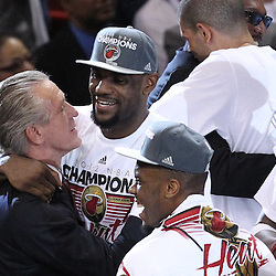 Jun 21, 2012; Miami, FL, USA; Pat Riley hugs Miami Heat small forward LeBron James (6) after winning the 2012 NBA championship at the American Airlines Arena. Miami won 121-106. Mandatory Credit: Derick E. Hingle-US PRESSWIRE