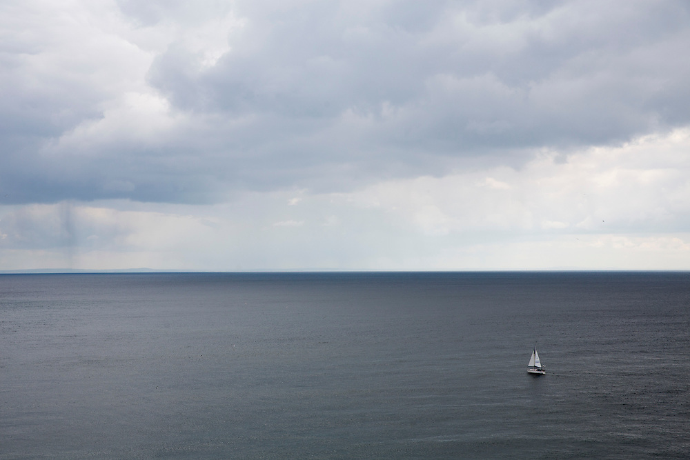 A boat with white sails on The English Channel from Folkestone, Kent, England, United Kingdom. The sky is full of white clouds. (photo by Andrew Aitchison / In pictures via Getty Images)