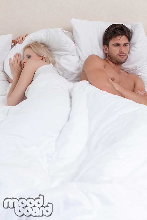 Young couple having relationship difficulties in hotel room