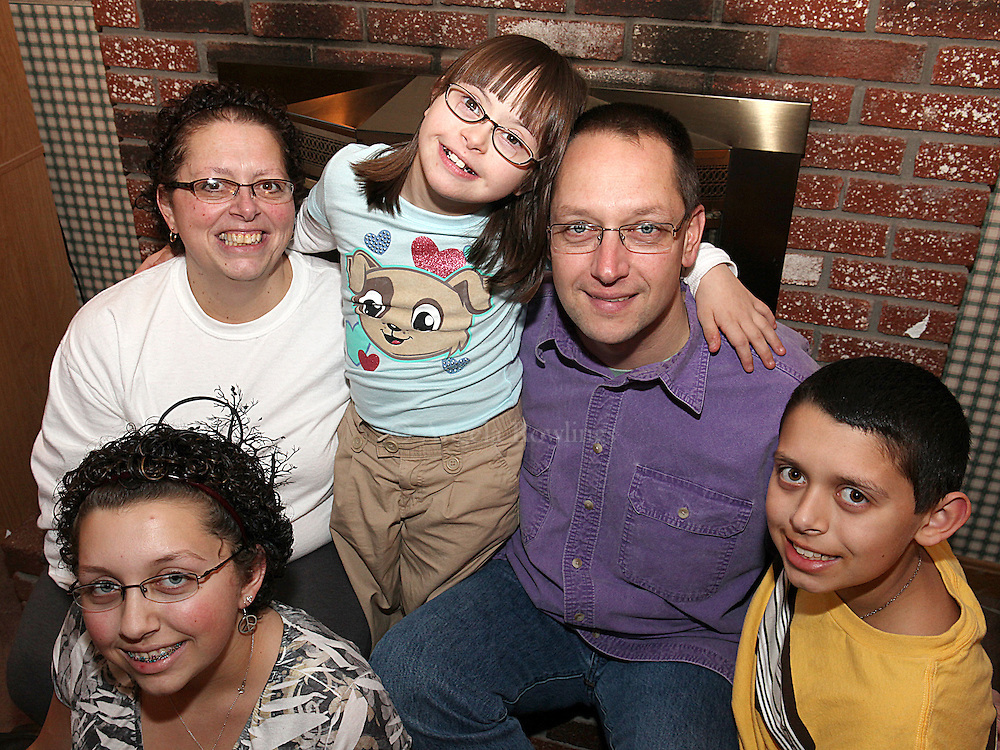 (112410  Lowell, MA) Karen and John Joslyn[cq] with their kids, Oliva, 13, Gillian[cq], 9, and Nathaniel, 12, Wednesday,  November 24, 2010.  Staff photo by Angela Rowlings.