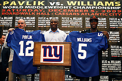 Sept 29, 2009; East Rutherford, NJ, USA; World Middleweight Champion Kelly Pavlik (l) and Paul Williams (r) pose with New York Giants Running Back Brandon Jacobs during the press conference announcing their December 5, 2009 World Middleweight Championship fight. The two will meet at Boardwalk Hall in Atlantic City, NJ.  Mandatory Credit: Ed Mulholland