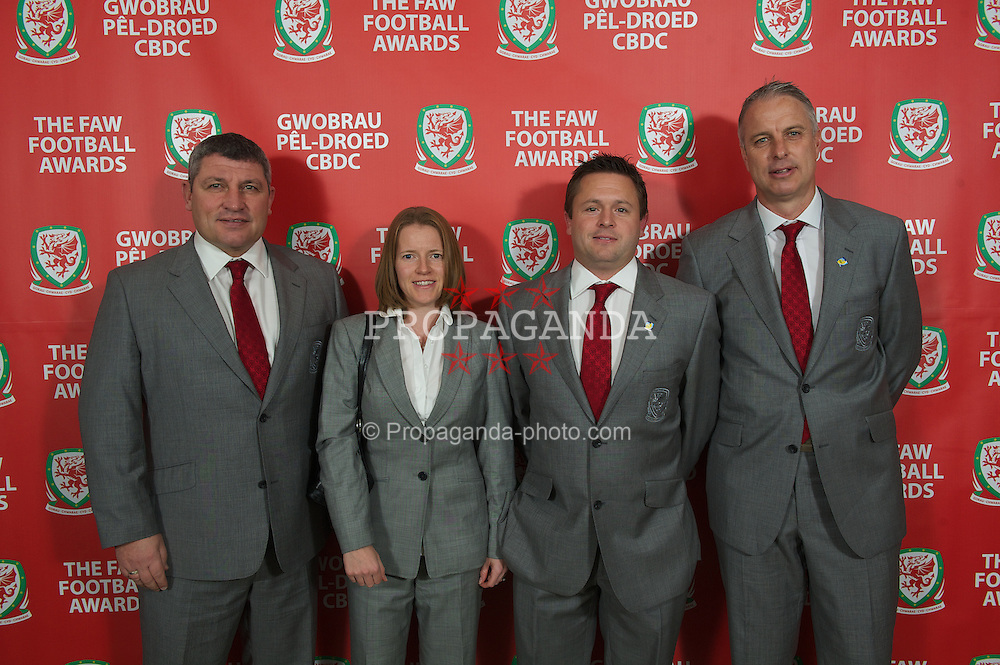 CARDIFF, WALES - Monday, October 8, 2012: Wales' coach Osian Roberts, performance analyst Esther Laugharne, physiotherapist David Weeks, coach Kit Symons during the FAW Player of the Year Awards Dinner at the National Museum Cardiff. (Pic by David Rawcliffe/Propaganda)