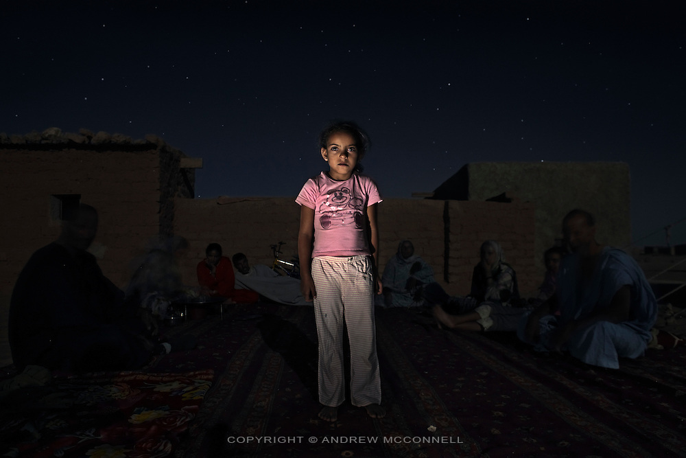 Chrifa Mohammed Salem, 6, pictured outside her home in Auserd refugee camp, Algeria..I go to school and then I come back and play with my sister. It is very hot, I want it to be cold. I want to be a teacher when I grow up. There is no water here..