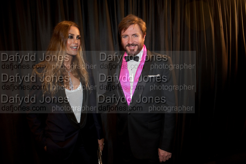 YASMINE LEBON; SIMON LEBON, GQ Man of the Year awards. The royal Opera House. Covent Garden. London. 6 September 2011. <br /> <br />  , -DO NOT ARCHIVE-© Copyright Photograph by Dafydd Jones. 248 Clapham Rd. London SW9 0PZ. Tel 0207 820 0771. www.dafjones.com.