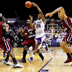 Jan 16, 2013; Baton Rouge, LA, USA; LSU Tigers guard Malik Morgan (24) passes as South Carolina Gamecocks forward Lakeem Jackson (30) defends during the second half of a game at the Pete Maravich Assembly Center. South Carolina defeated LSU 82-73. Mandatory Credit: Derick E. Hingle-USA TODAY Sports