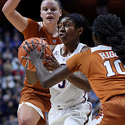 UNCASVILLE, CONNECTICUT- DECEMBER 4:  Crystal Dangerfield #5 of the Connecticut Huskies drives to the basket defended by Lashann Higgs #10 of the Texas Longhorns during the UConn Huskies Vs Texas Longhorns, NCAA Women's Basketball game in the Jimmy V Classic on December 4th, 2016 at the Mohegan Sun Arena, Uncasville, Connecticut. (Photo by Tim Clayton/Corbis via Getty Images)