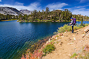 Backpacker on the Bishop Pass Trail at Long Lake, John Muir Wilderness, Sierra Nevada Mountains, California USA