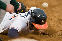 Virginia Cavaliers INF David Adams (23) dives back to first as the pick off attempt results in a passed ball.  The #16 ranked Virginia Cavaliers baseball team defeated the Siena Saints 17-2 at the University of Virginia's Davenport Field in Charlottesville, VA on February 29, 2008.