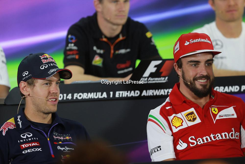 &copy; Photo4 / LaPresse<br /> 20/11/2014 Abu Dhabi, UAE<br /> Sport <br /> Grand Prix Formula One Abu Dhabi 2014<br /> In the pic: Press Conference, Sebastian Vettel (GER), Red Bull Racing, RB10 and Fernando Alonso (ESP) Scuderia Ferrari F14-T