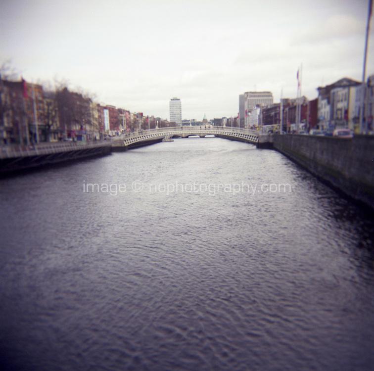 View of the Halpenny bridge from he new Liffey Pedestrian Bridge in Dublin Ireland