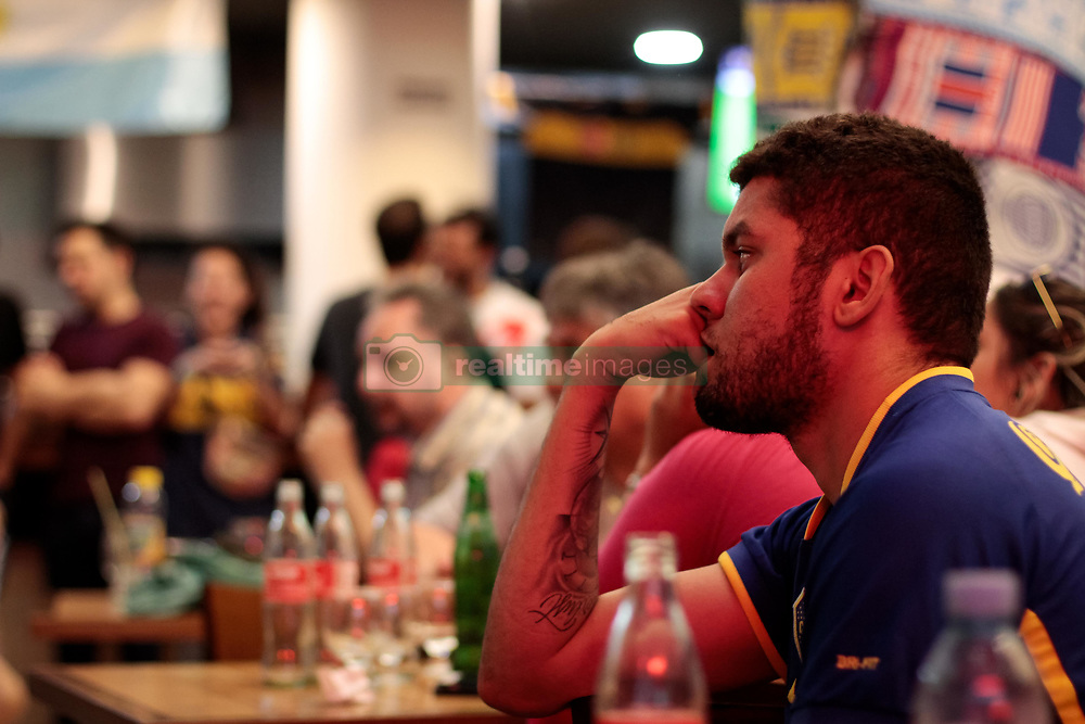 December 9, 2018 - Buenos Aires, Argentina - Fans of Boca Juniors watch a broadcast of the final against River Plate in La Boca during the second leg of the final match of Copa CONMEBOL Libertadores 2018 between River Plate and Boca Juniors on December 9, 2018 in Buenos Aires, Argentina. Due to the violent incidents of November 24th, CONMEBOL decided to reschedule the game and move it to Madrid. (Credit Image: © Federico Rotter/NurPhoto via ZUMA Press)