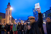 Frankfurt am Main | 28 Apr 2014<br /> <br /> Am Montag (28.04.2014) veranstalteten etwa 200 Menschen an der Hauptwache in Frankfurt am Main sogenannte Montagsdemos gegen Hartz IV und die Agenda 2010 und dann sp&auml;ter f&uuml;r den Frieden, gegen den Krieg etc., am zweiten Teil der Montagsdemo nahmen AfD-Aktivisten und die Neonazi-Aktivistin Sigrid Sch&uuml;&szlig;ler (NPD, RNF/Ring Nationaler Frauen) teil.<br /> Hier: Ein Aktivist h&auml;lt das Grundgesetz in die H&ouml;he, im Hintergrund die Katharinenkirche.<br /> <br /> &copy;peter-juelich.com<br /> <br /> [No Model Release | No Property Release]