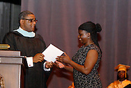 Principal Nelson M. Stone, Jr. presents a posthumous diploma to the mother of Antonio Jones during the Fiftieth Meadowdale High School commencement at the Dayton Masonic Center, Saturday, May 21, 2011. Jones passed away during his sophomore year at Meadowdale.