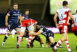 Neil Briggs of Sale Sharks (bottom) makes a tackle - Mandatory by-line: Matt McNulty/JMP - 16/09/2016 - RUGBY - Heywood Road Stadium - Sale, England - Sale Sharks v Gloucester Rugby - Aviva Premiership
