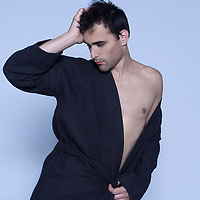 studio shot on isoltaded background portrait of handsome man in bathrobe