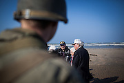 A veteran walks on  Utah beach for the 69th anniversary of the D Day