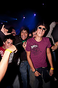 GROUP OF MALE CLUBBERS LOOKING AT CAMERA HAPPY WITH SUNGLASSES