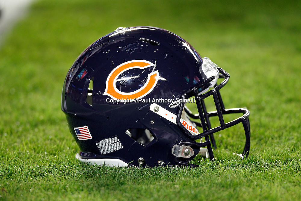 A Chicago Bears helmet lies on the grass during the NFL week 11 football game against the Miami Dolphins on Thursday, November 18, 2010 in Miami Gardens, Florida. The Bears won the game 16-0. (©Paul Anthony Spinelli)