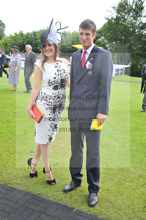 KELLY BROOK and JAKE HERBERT at the 3rd day of the 2012 Glorious Goodwood racing festival at Goodwood Racecourse, West Sussex on 2nd August 2012.