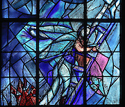 Descent from the cross, stained glass window, 1974, by Marc Chagall, 1887-1985, with the studio of Jacques Simon, left lancet window in the axial chapel of the apse of the Cathedrale Notre-Dame de Reims or Reims Cathedral, Reims, Champagne-Ardenne, France. The cathedral was built 1211-75 in French Gothic style with work continuing into the 14th century, and was listed as a UNESCO World Heritage Site in 1991. Picture by Manuel Cohen