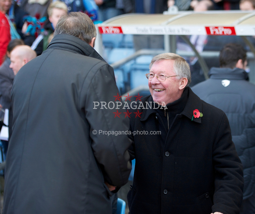 BIRMINGHAM, ENGLAND - Saturday, November 13, 2010: Aston Villa's manager Gerard Houllier and Manchester United's manager Alex Ferguson during the Premiership match at Villa Park. (Photo by David Rawcliffe/Propaganda)