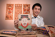 Vietnamese artist Nguyen Minh Thanh, curator of the library's collection of Vietnamese folk art, with scroll-like paintings and masks used in religious ceremonies...These colorful masks, which participants wear on the forehead during religious ceremonies, are part of the library's Vietnamese art collection.