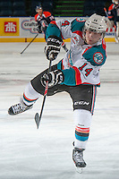 KELOWNA, CANADA - DECEMBER 27: Rourke Chartier #14 of the Kelowna Rockets takes a shot during warm up against the Kamloops Blazers  on December 27, 2013 at Prospera Place in Kelowna, British Columbia, Canada.   (Photo by Marissa Baecker/Shoot the Breeze)  ***  Local Caption  ***
