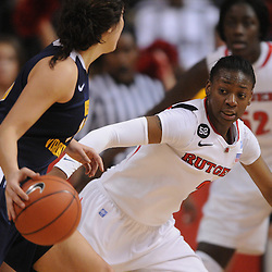 Rutgers Scarlet Knights guard Erica Wheeler (3) defends West Virginia Mountaineers guard Liz Repella (10) during second half Big East NCAA women's basketball action during Rutgers' 67-58 victory over West Virginia at the Louis Brown Rutgers Athletic Center.