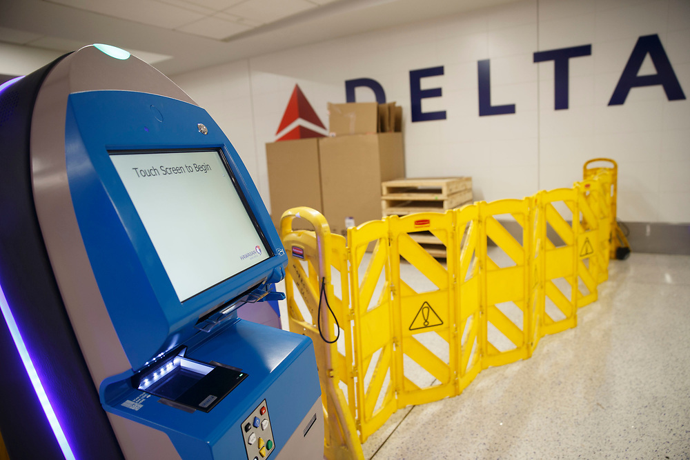 New Hawaiian Airlines check-in kiosks stand surrounded by barriers as boxes stand in front of Delta signage in Terminal 5 as the airline relocation begins at Los Angles International Airport (LAX) on Friday, May 12, 2017 in Los Angeles, Calif. Delta Airlines will move from Terminals 5 and 6 to Terminals 2 and 3, forcing 19 other carriers to shift their operations into the facilities vacated by Delta.  © 2017 Patrick T. Fallon