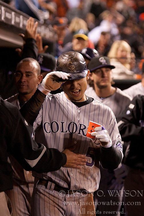 August 30, 2010; San Francisco, CA, USA;  Colorado Rockies center fielder Carlos Gonzalez (5) is congratulated by teammates after scoring the game winning run against the San Francisco Giants during the ninth inning at AT&T Park.  Colorado defeated San Francisco 2-1.