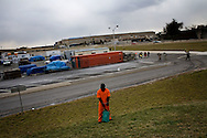 Thousands march to the Pentagon (40th anniversary of the 1967 march) in protest of the Iraq war. Protester dressed as a Guantanamo prisoner stands with Pentagon in background...photo: Hector Emanuel