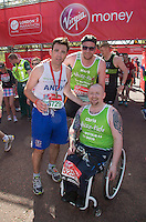 Relieved, happy and tired athletes at the end of the Virgin Money London Marathon 2014 on Sunday 13 April 2014<br /> Photo: Roger Allan/Virgin Money London Marathon<br /> media@london-marathon.co.uk