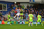 Queens Park Rangers forward Sebastian Polter (17) rises above Reading midfielder Oliver Norwood (16) during the EFL Sky Bet Championship match between Queens Park Rangers and Reading at the Loftus Road Stadium, London, England on 15 October 2016. Photo by Jon Bromley.