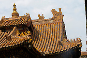 Yonghe Gong (Lama Temple). Figures of an immortal on a phenix, fabled creatures and a dragon's head on the roofs.
