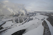 Suncor Millenium oil sand plant site & tailing pond w/ earthen dam. adjacent to the Athabasca River - Tar Sand (Oil Sand) mining and refining near Ft McMurray Alberta