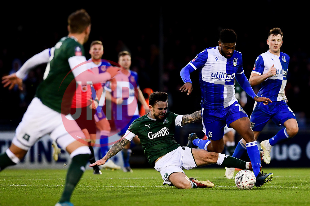 Mark Little of Bristol Rovers is challenged by Dom Telford of Plymouth Argyle - Mandatory by-line: Ryan Hiscott/JMP - 01/12/2019 - FOOTBALL - Memorial Stadium - Bristol, England - Bristol Rovers v Plymouth Argyle - Emirates FA Cup second round