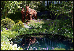 The war horse Joey in the garden called no Man's Land ABF The Soldiers Charity Garden to mark the centenary of World War One on the VIP preview day at the Chelsea Flower Show. London, United Kingdom. Monday, 19th May 2014. Picture by Andrew Parsons / i-Images