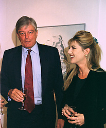 MR ARCHIE STIRLING  husband of Dame Diana Rigg and MISS SARAH KEELING, at an exhibition in London on 28th October 1997.MCN 40