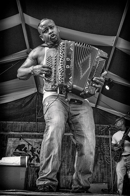 Dwayne Dopsie of Dwayne Dopsie and the Zydeco Hellraisers performs on the Fais Do-Do Stage during the 2013 New Orleans Jazz & Heritage Music Festival at Fair Grounds Race Course on April 27, 2013 in New Orleans, Louisiana. USA.