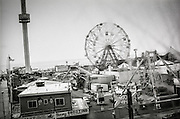 The Wonder Wheel and other rides are visible through the window of a D train on the way to Coney Island, Brooklyn.