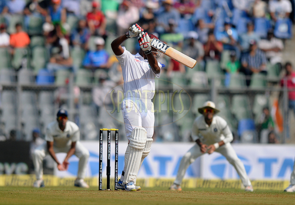 Kieran Powell of West Indies bats during day one of the second Star Sports test match between India and The West Indies held at The Wankhede Stadium in Mumbai, India on the 14th November 2013<br /> <br /> This test match is the 200th test match for Sachin Tendulkar and his last for India.  After a career spanning more than 24yrs Sachin is retiring from cricket and this test match is his last appearance on the field of play.<br /> <br /> Photo by: Pal PIllai - BCCI - SPORTZPICS<br /> <br /> Use of this image is subject to the terms and conditions as outlined by the BCCI. These terms can be found by following this link:<br /> <br /> http://sportzpics.photoshelter.com/gallery/BCCI-Image-Terms/G0000ahUVIIEBQ84/C0000whs75.ajndY