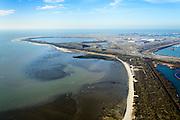 Nederland, Zuid-Holland, Rotterdam, 18-02-2015; Brielse Gat met zicht op De Slufter vanaf de Brielse Gatdam, Tweede Maasvlakte (MV2) in het verschiet. De Slufter is een grootschalige opslagplaats voor vervuild havenslib. De verontreinigde baggerspecie komt voort uit het onderhoudsbaggerwerk in de Rotterdamse haven waarbij de haven op diepte wordt gehouden. Op de Tweede Maasvlakte wordt gewerkt aan de inrichting van de haventerreinen.<br /> The Slufter area in the South-West of the Netherlands, large-scale depot of contaminated harbor sludge from the Port of Rotterdam. Along the edge of the Slufter windmills are built. The Second Maasvlakte in the background<br /> luchtfoto (toeslag op standard tarieven);<br /> aerial photo (additional fee required);<br /> copyright foto/photo Siebe Swart