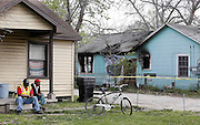 Neighbors look on as HFD investigators work the scene of a fatality fire at 5500 Bunte St. on Tuesday, March 22, 2016 in Houston, TX. Clinton Russell perished in the fire but his wife Kay Russell and his daughter Sandra Russell escaped the fire uninjured. (Photo: Thomas B. Shea/For the Chronicle)