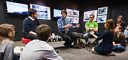 James Balog (center), an award winning nature and environmental photojournalist, answers questions from photojournalism students in the gallery of the Angus and Betty McDougall Center for Photojournalism Studies at the Missouri School of Journalism in Columbia, Missouri. Balog was at the university to receive a Missouri Honor Medal In recognition of three decades of using the photographic image to help the public understand the impact of environmental change. Balog is the founder and director of the Extreme Ice Survey (EIS) and the Earth Vision Trust.