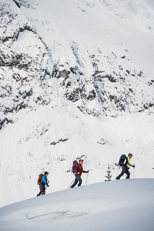 Hank Wissenz, John Connolly, and Emily Bodner below the flanks of Hut Peak, Howson Range, British Columbia.
