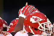 A group of Kansas City Chiefs players join hands during the NFL week 12 regular season football game against the Oakland Raiders on Thursday, Nov. 20, 2014 in Oakland, Calif. The Raiders won their first game of the season 24-20. ©Paul Anthony Spinelli