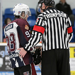 "TRENTON, ON  - MAY 4,  2017: Canadian Junior Hockey League, Central Canadian Jr. ""A"" Championship. The Dudley Hewitt Cup. Game 6 between the Trenton Golden Hawks and The Dryden GM Ice Dogs.  Kris Hamlin #93 of the Dryden GM Ice Dogs discusses the play with OHA Referee Thompson <br /> (Photo by Amy Deroche / OJHL Images)"