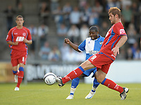 Football<br /> Bristol Rovers vs Aldershot Town, Carling Cup 1st Round, Memorial Stadium, Bristol, UK<br /> John Grant of Aldershot Town and Jo Kuffour of Bristol Rovers <br /> 11/08/2009<br /> Credit Colorsport/Dan Rowley
